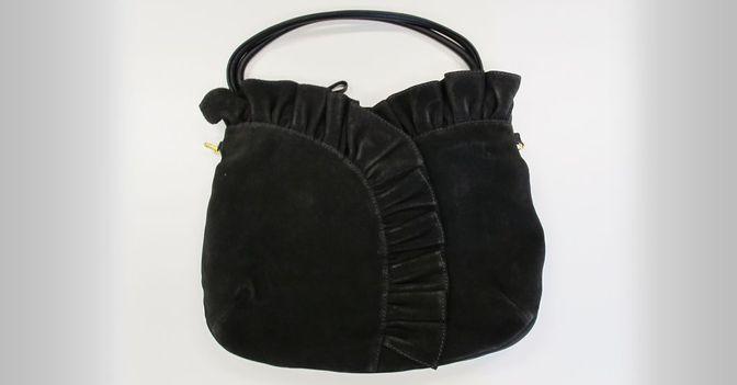 Die Tasche kann sowohl als Trage-, als auch Umhängetasche benutzt werden